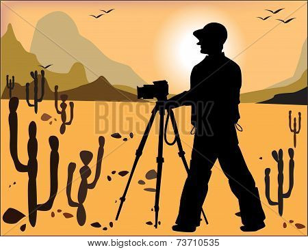 Silhouette Of The Photographer On The Background Of The Desert