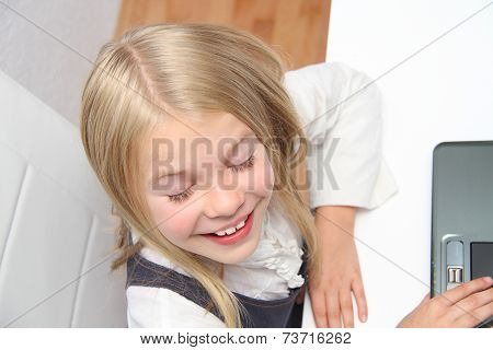 Young Girl Using Laptop At Home