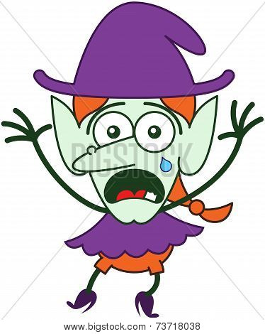 Cute Halloween witch crying and feeling scared