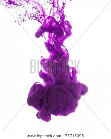 Studio shot of purple ink in water, isolated on white background