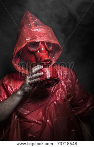 Ecology, nuclear disaster, man with red mask and plastic suit
