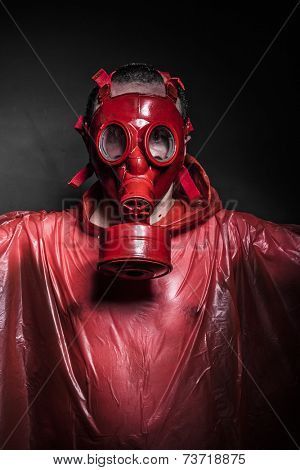 emission nuclear concept, man with red gas mask