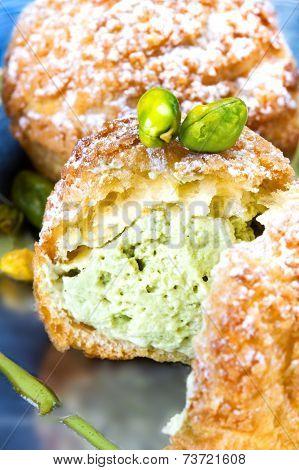 Pistachio Dessert With Pistachios Cream. Profiteroles With Pistachios Cream, Studio Shot.