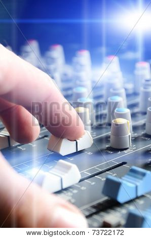 Man Adjusting Audio Mixer With Flare
