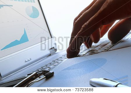 Analyst Working On A Keyboard