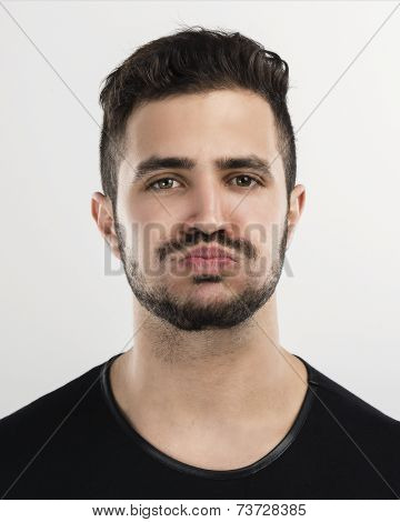 Studio portrait of a handsome young man with a bored expresion