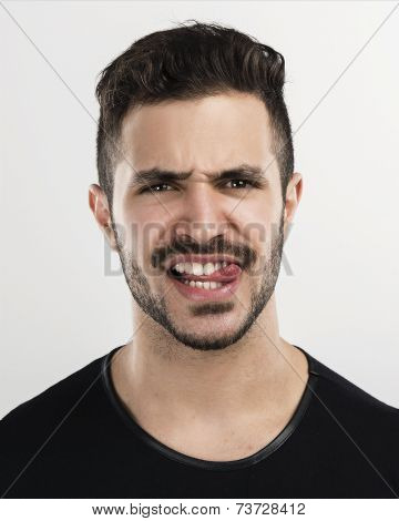 Studio portrait of a handsome young man with a mad face