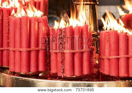 Bundles Of Red Prayer Candles