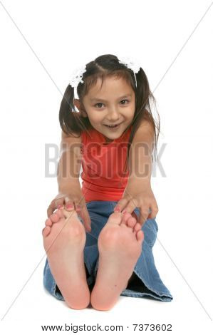 Cute Ponytailed Girl Touching Bare Feet