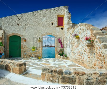 Traditional greek door with a great view on Crete island, Greece