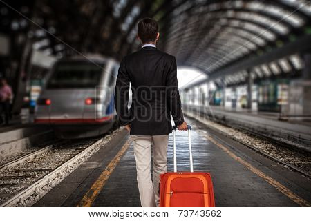 Business man with trolley bag at the train station