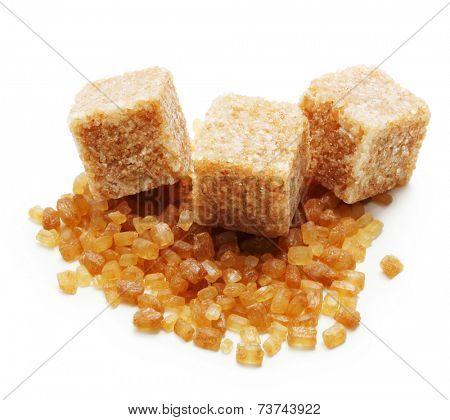 Brown cane sugar cubes n white background.