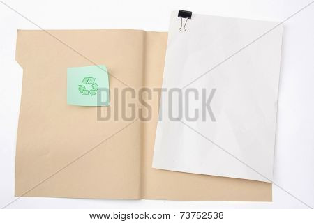 A manila file folder with a clipping path and a recycle sign