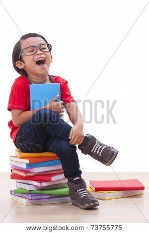 Cute boy holding a book