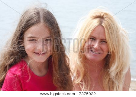 Mother And Daugher On The Beach