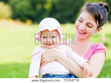 Adorable Baby With Her Mother