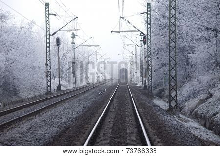 Railroad tracks in winter fog