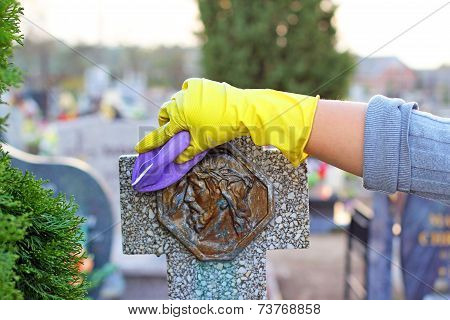 cleaning of the monument at cemetery