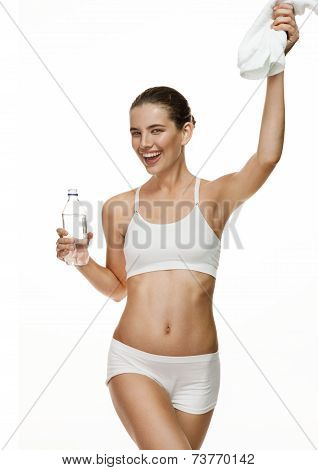 Attractive smiling girl holding water bottle and white towel