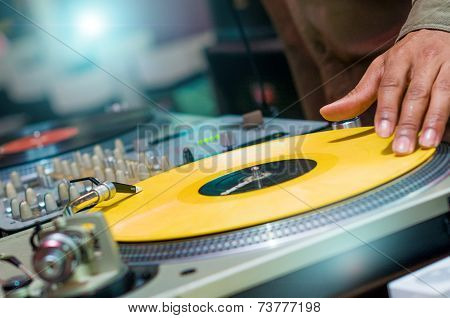 DJ playing vinyl on turntable