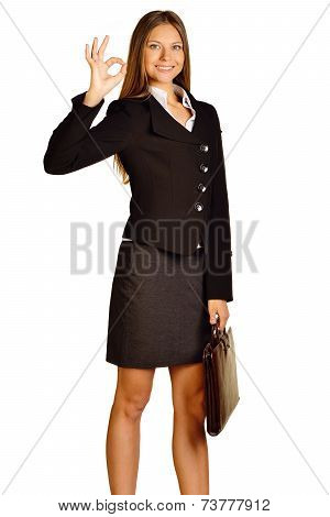 business woman standing with brown travel bag showing OK sign.