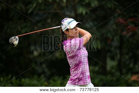 KUALA LUMPUR, MALAYSIA - OCTOBER 11, 2014: Beatriz Recari of Spain tees off at the fourth hole of the KL Golf & Country Club during the 2014 Sime Darby LPGA Malaysia golf tournament.