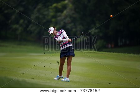 KUALA LUMPUR, MALAYSIA - OCTOBER 11, 2014: Chella Choi of South Korea makes a shot from the fairway of the ninth hole of the KLGC Club during the 2014 Sime Darby LPGA Malaysia golf tournament.
