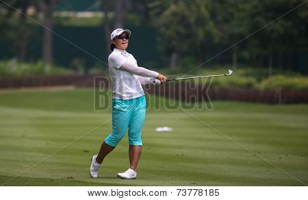 KUALA LUMPUR, MALAYSIA - OCTOBER 10, 2014: Amy Yang of South Korea reacts after playing her shot at the ninth hole of the KL Golf & Country Club at the 2014 Sime Darby LPGA Malaysia golf tournament.