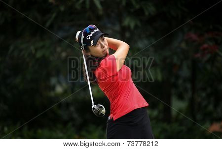 KUALA LUMPUR, MALAYSIA - OCTOBER 11, 2014: Mi Jung Hur of South Korea tees off at the fourth hole of the KL Golf & Country Club during the 2014 Sime Darby LPGA Malaysia golf tournament.