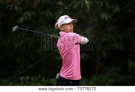 KUALA LUMPUR, MALAYSIA - OCTOBER 11, 2014: Pernila Lindberg of Sweden tees off at the fourth hole of the KL Golf & Country Club during the 2014 Sime Darby LPGA Malaysia golf tournament.