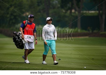 KUALA LUMPUR, MALAYSIA - OCTOBER 10, 2014: Amy Yang of South Korea walks on the fairway of the ninth hole of the KL Golf & Country Club at the 2014 Sime Darby LPGA Malaysia golf tournament.