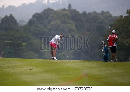 KUALA LUMPUR, MALAYSIA - OCTOBER 10, 2014: Jessica Korda of the USA plays a shot on the fairway during the 2014 Sime Darby LPGA Malaysia golf tournament in the Kuala Lumpur Golf and Country Club.