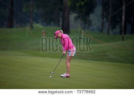 KUALA LUMPUR, MALAYSIA - OCTOBER 11, 2014: Morgan Pressel of the USA putts on the green of the third hole of the KL Golf & Country Club during the 2014 Sime Darby LPGA Malaysia got tournament.
