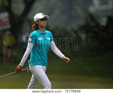 KUALA LUMPUR, MALAYSIA - OCTOBER 10, 2014: Na Yeon Choi of South Korea walks to the green of the ninth hole of the KL Golf & Country Club at the 2014 Sime Darby LPGA Malaysia golf tournament.