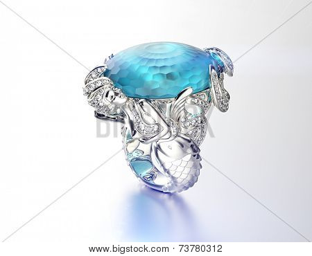 Golden Engagement Ring with Blue topaz. Fashion Jewelry background