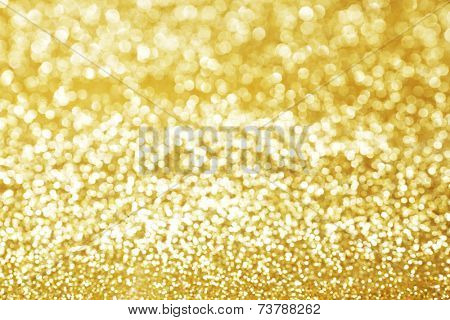 Abstract shining glitters gold holiday bokeh background