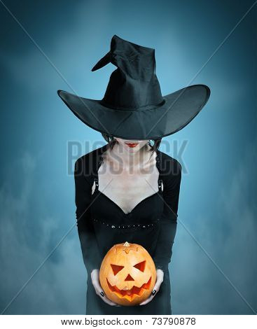 Mystery Witch With Halloween Pumpkin