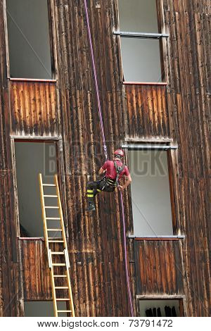 Firefighter Climbing During The Ascent Abseiling From A Building