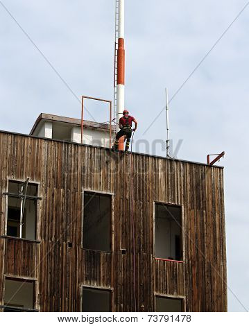 Fireman Climbing Expert During The Ascent Abseiling From A Building