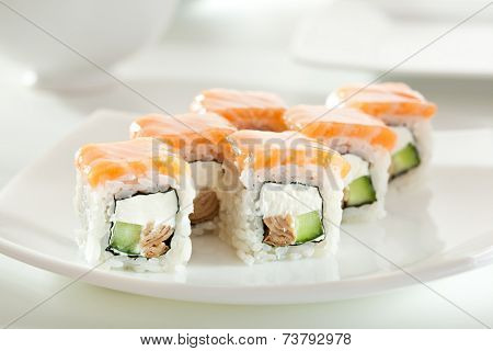 Maki Sushi made of Omelet, Cream Cheese and Cucumber inside. Salmon  outside