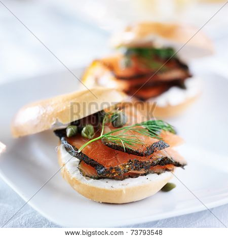 bagel with salmon, cream cheese, dill, and capers