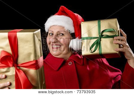 Happy Old Lady In Red With Wrapped Golden Gifts.