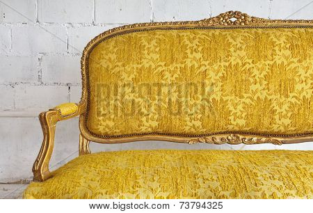 vintage luxury yellow sofa and white wall background