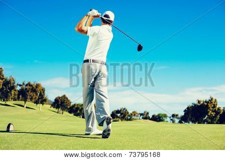 Golfer Playing on Beautiful Golf Course