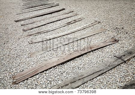 Old Wooden Sleepers On Gravel. Abandoned Railroad Without Rails