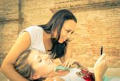 picture of two women taking cell phone  - concept about communication, internet and youth. two girls with smartphone ** Note: Soft Focus at 100%, best at smaller sizes - JPG