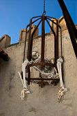 image of torture  - Skeleton in a cage of torture in an amusement park - JPG