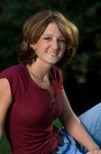 Head Shot of Smiling Young Woman Outdoors poster