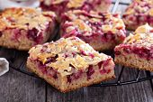 picture of racks  - Berry cake bars with caramel almond topping  on a cooling rack - JPG