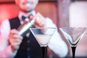 foto of bartender  - Bartender is making cocktail at bar counter